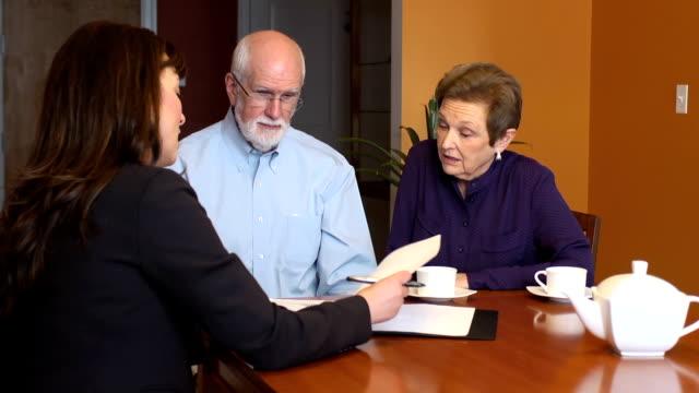 Female Professional Talks with Senior Couple