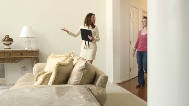 Female Real Estate Agent Showing Home