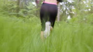 TS Female runner running across high grass