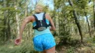 TS Female runner running through the forest