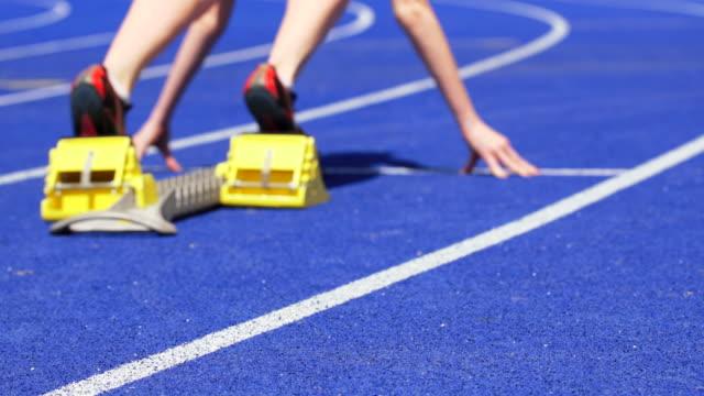 HD Female Runner Sprinting Off Starting Block Slow Motion