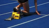 HD Female Runner Sprinting Off Starting Block