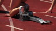 Female Runner Sprinting Off Starting Block