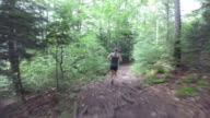 Female Running along a forest path