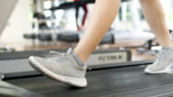 Female running and  exercising at gym