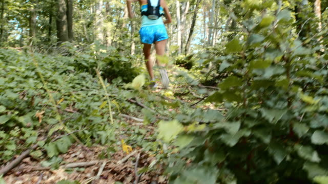 TU Female running through the forest