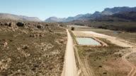 Female runs through the extreme terrain of the Cederberg in South Africa
