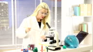 Female scientist in research laboratory. Science experiment.