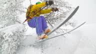 SLO MO Female skier skiing in powder snow