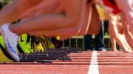 SLO MO Female Sprinters Preparing At The Starting Block