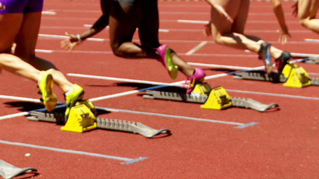 SLO MO Female Sprinters Starting Off Running Blocks