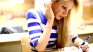 Female student cheating in exam.