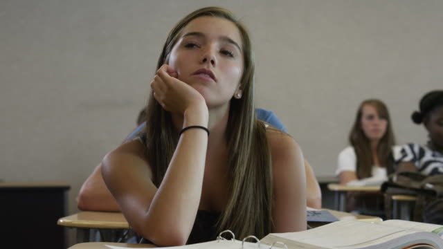 MS DS Female student (16-17) in classroom looking up / Spanish Fork City, Utah, USA