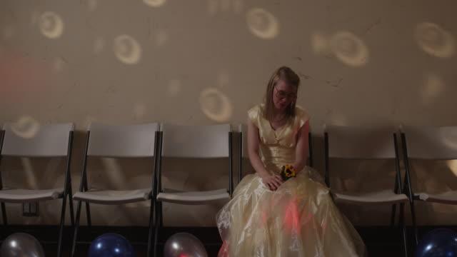 MS Female student sitting alone on prom night / Cedar Hills, Utah, USA