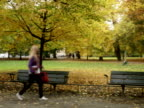 A female student walking in a park Sweden.