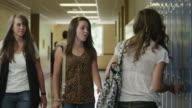 MS Female students (14-17) arguing in corridor / Spanish Fork City, Utah, USA
