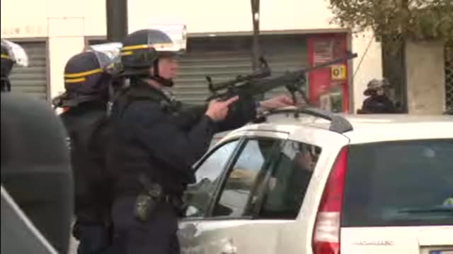 A female suicide bomber blows herself up and one other jihadist dies in a police raid in Paris as explosions and automatic gunfire ring out in an...