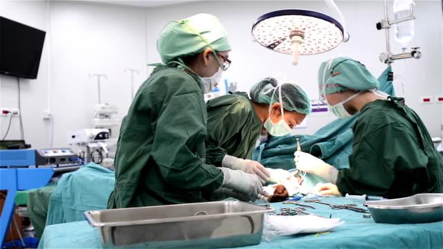 Female surgeon and team