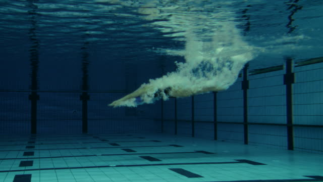 Female Swimmer Jumping Into Pool