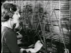 B/W 1925 PROFILE female telephone switchboard operator / newsreel