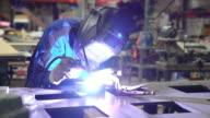 Female TIG welder working in workshop