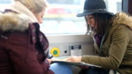 Female tourists looking at the map in the bus