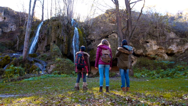 Female tourists take photos of nature