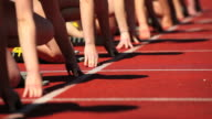 Female Track Runners at Starting Line