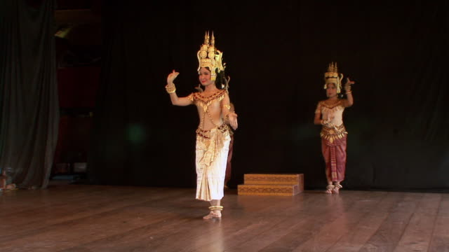 MS Female trio of apsara dancers performing dance on stage / Phnom Penh, Cambodia