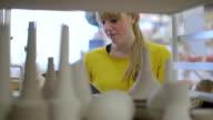 female worker in ceramics craft workshop