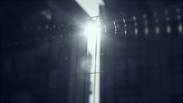 Fence, gate, grille, rays of the sun, apartments in the background