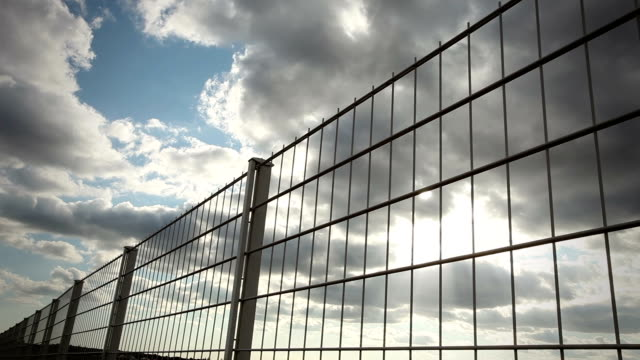 fence with clouds - time lapse