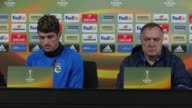 Fenerbahce's head coach Dick Advocaat and defender Roman Neustaedter attend a press conference the day before the UEFA Europa League Round of 32...