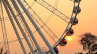 Ferris wheel at sunset in evening