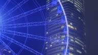 Ferris wiel in Hong Kong City's nachts, tilt omlaag.