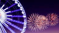 Ferris wheel with fireworks