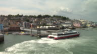 LOW AERIAL Ferry and townscape / Cowes, Isle of Wight, United Kingdom