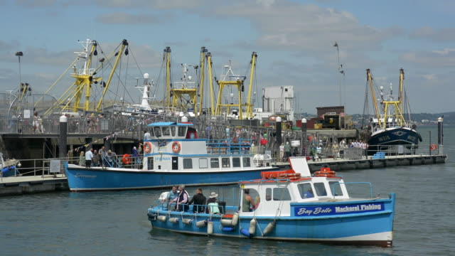 Ferry boats and fishing boats at the port of Brixham.