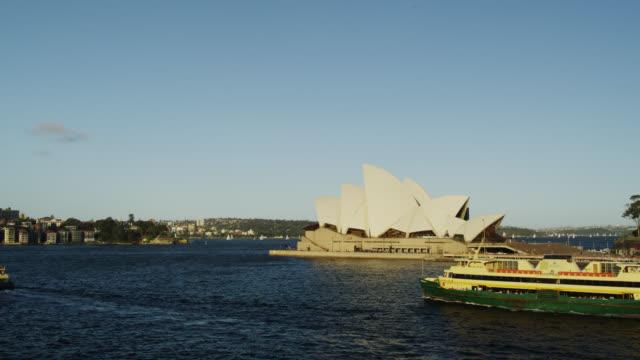 Ferry Boats passing the Sydney Opera House, Sydney, New South Wales, Australia