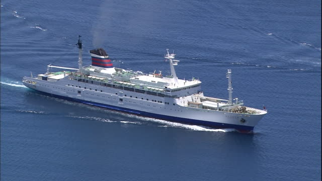 A ferry cruises across the Pacific Ocean.