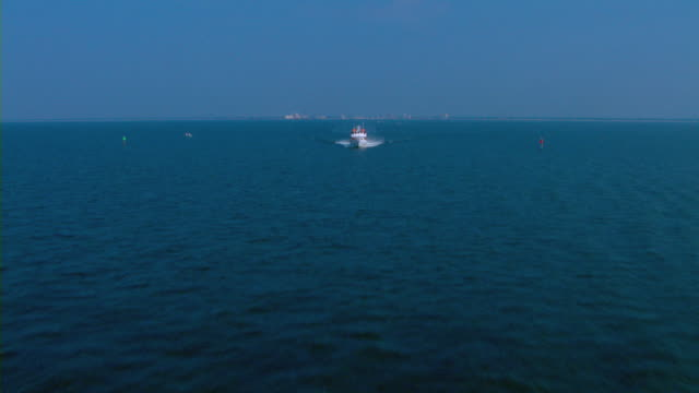 A ferry travels in the Gulf Coast off the shore of Mississippi.