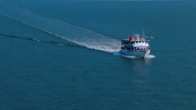 A ferry travels through Ship Island Harbor in Mississippi.