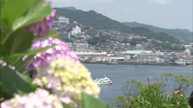 A ferryboat drifts through the Port of Nagasaki.