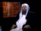 9th man held ITN London GIR Sheikh OmarBakri Muhammad interview SOT MS OmarBakri Muhammad thru reception area into building PULL PAN as along to...