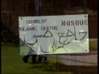 9th man held LIB ENGLAND Surrey Crawley Crawley Mosque with sign on door Seq Police carrying out investigations at scene