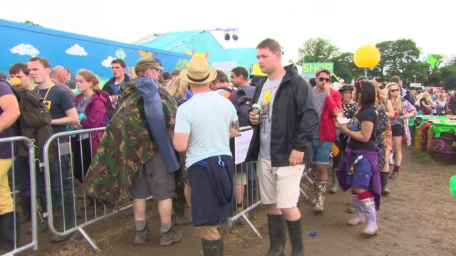 ATMOSPHERE Festival goers queue to charge their mobiles at the EE tent at Glastonbury Festival General Views at Glastonbury Festival Site on June 27...