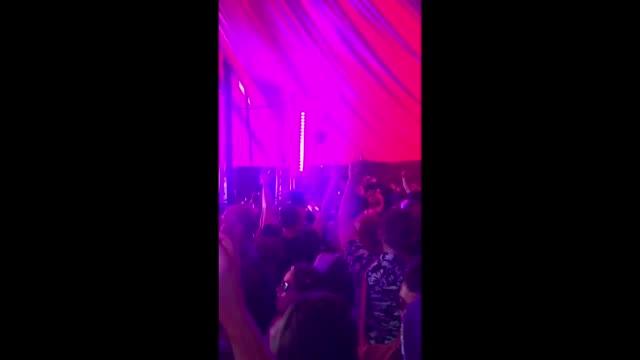 Festivalgoers chant the name of Labour leader Jeremy Corbyn in the Stonebridge Bar at Glastonbury Festival