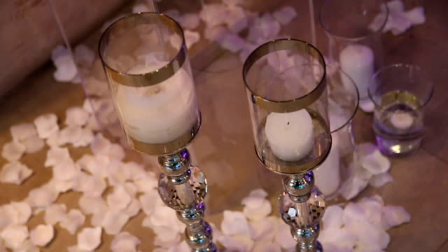 Festive wedding decor in the restaurant with flowers and candles