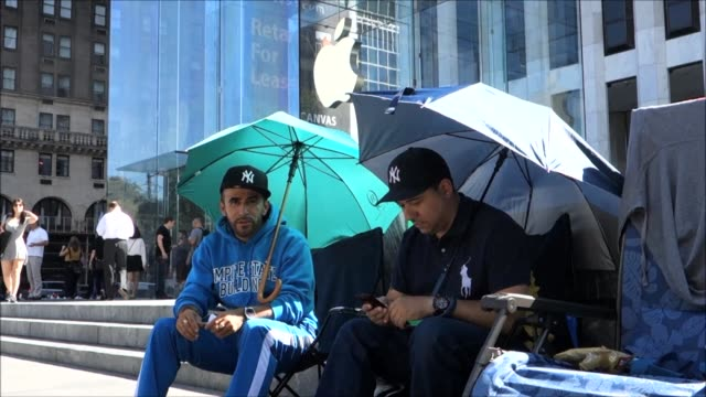 A few keen iPhone fans were camped outside Apples Fifth Avenue store in New York on Wednesday days ahead of the devices Friday release