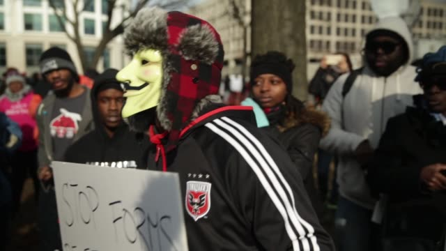 A few protesters who wear V for Vendetta masks are told to leave as they attempt to join the postmarch rally on Capitol Hill December 13 Washington...